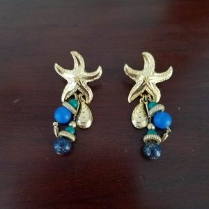 Jewelry - Gold star fish earrings with hanging beads